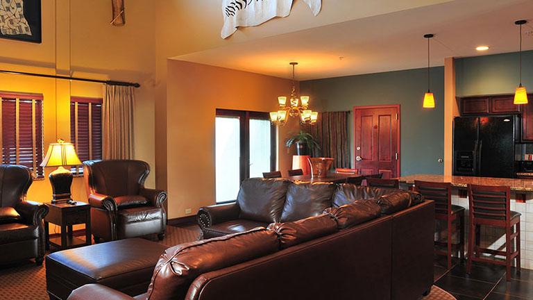 The living and dining space inside a three to five bedroom suite at Kalahari