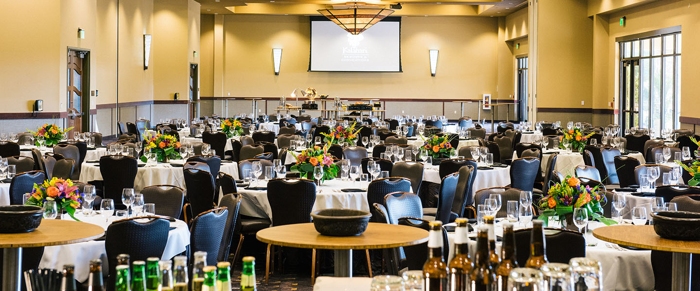 A smaller meeting room set up banquet style with round tables at Kalahari Resorts & Conventions in Pocono Mountains, Pennsylvania
